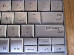 "Photo of a keyboard on which the shift key has been doctored to read ""paradigm shift"""
